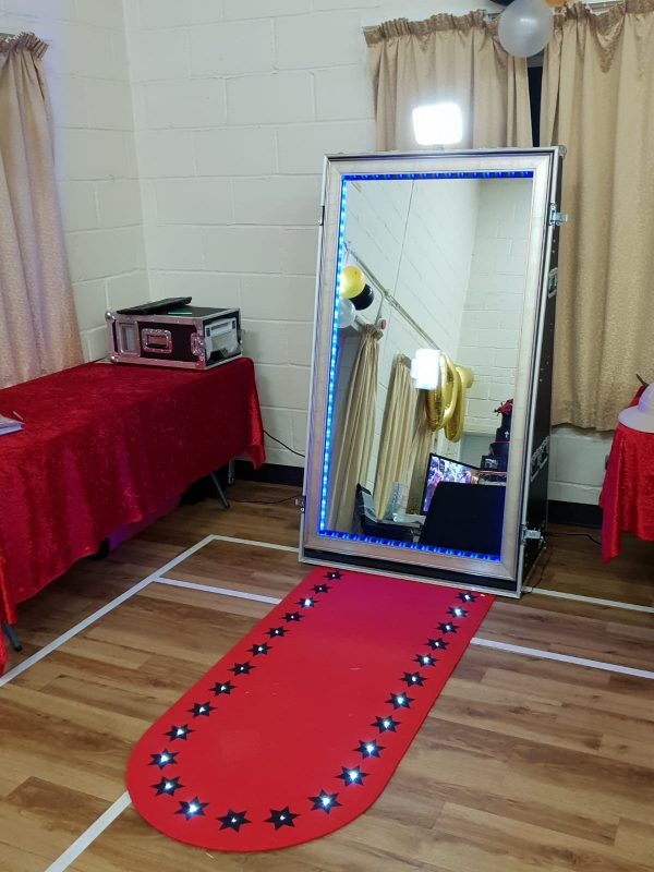 magic mirror photo booth for hire, with props