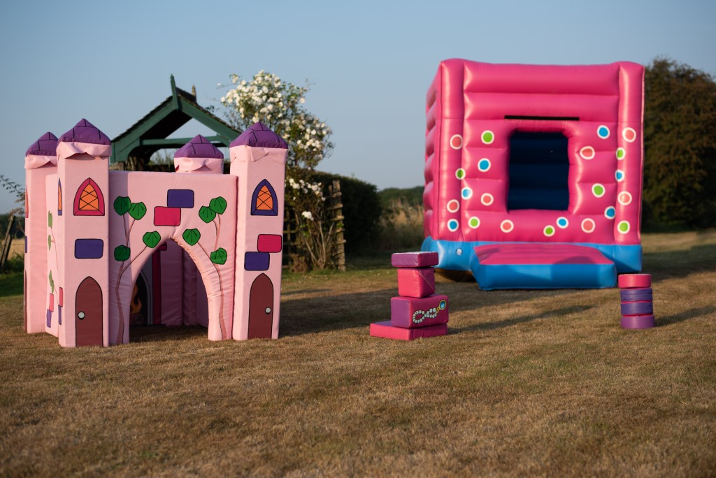 pink bouncy castle, pink Fairy Tale play castle to hire