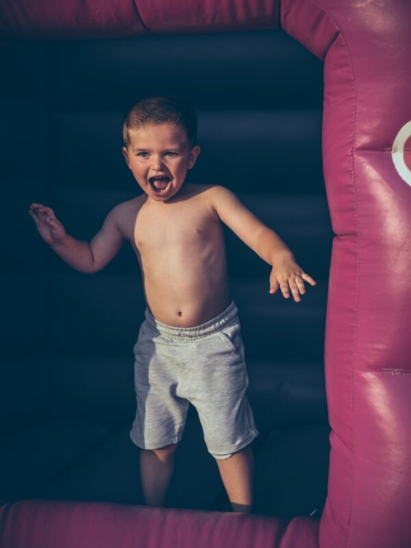 pink bouncy castle and inflatables to hire