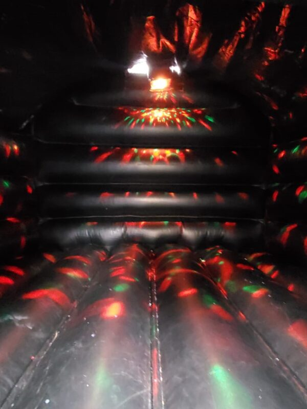 disco bouncy castle inside with lights